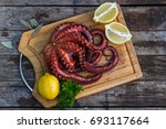 boiled octopus ready for serve... | Shutterstock . vector #693117664