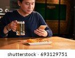 vietnamese mature man drinking... | Shutterstock . vector #693129751