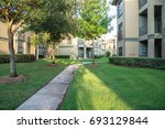clean lawn and tidy oak trees... | Shutterstock . vector #693129844