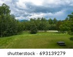 a small picnic table below  the ... | Shutterstock . vector #693139279