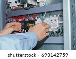 electrician specialist checking ... | Shutterstock . vector #693142759
