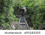 railroad tracks in forest on... | Shutterstock . vector #693183355