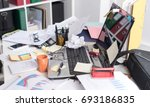 messy and cluttered office desk | Shutterstock . vector #693186835