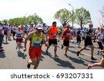 riga marathon 05.19.2013  latvia   Shutterstock . vector #693207331