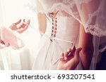 helping the bride to put her... | Shutterstock . vector #693207541