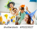 family carving pumpkins | Shutterstock . vector #693223327