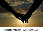 be hand in hand.  silhouette... | Shutterstock . vector #693225061