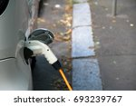 electric car plugged with via... | Shutterstock . vector #693239767