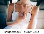 girl in a white dress with a... | Shutterstock . vector #693242215