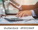 a businessman analyzing... | Shutterstock . vector #693313669