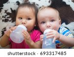 closeup view of two babies... | Shutterstock . vector #693317485