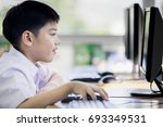 happy asian boy in student... | Shutterstock . vector #693349531