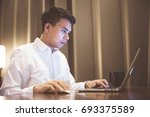 young asian businessman working ... | Shutterstock . vector #693375589