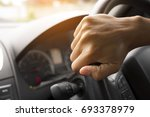 Driver's Hands On The Steering...
