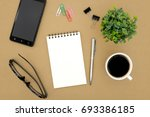 notebook on brown background... | Shutterstock . vector #693386185