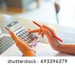 closeup business woman hand... | Shutterstock . vector #693396379