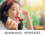 Eating Cake. Cute Asian Young...