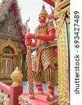 Small photo of Standing giant guard statue in Wat Si Uthumporn temple in Nakhon Sawan, Thailand