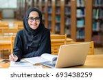 beautiful arabic business woman ... | Shutterstock . vector #693438259