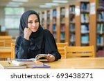 muslim woman reading book at... | Shutterstock . vector #693438271