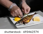 man putting thyme onto tasty... | Shutterstock . vector #693462574