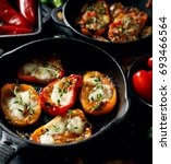 grilled  peppers  stuffed with... | Shutterstock . vector #693466564