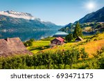 sunny summer scene in lofthus...   Shutterstock . vector #693471175