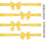 set of golden yellow bows and... | Shutterstock . vector #693472855