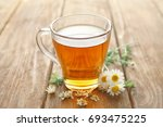 cup of chamomile tea on wooden