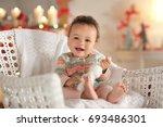 Cute Little Baby In Wicker...