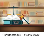 employment law books on a table ... | Shutterstock .eps vector #693496039