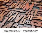 old letterpress wood type... | Shutterstock . vector #693505489