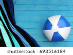 at the beach  water ball and... | Shutterstock . vector #693516184