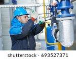 technician of heating system in ... | Shutterstock . vector #693527371