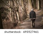 elderly man going away in park. ... | Shutterstock . vector #693527461