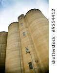 Large silo's stretch into the sky - stock photo