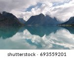 sunset at lake stryn with... | Shutterstock . vector #693559201