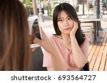 two girls making photos   Shutterstock . vector #693564727