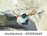 rock climber ascending a...   Shutterstock . vector #693583669