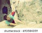 rock climber ascending a... | Shutterstock . vector #693584359