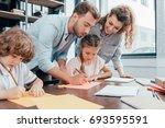 parents doing homework with... | Shutterstock . vector #693595591
