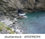 Small photo of The legendary beach and Merlin's Cave beneath the great Tintagel Castle, supposed birthplace of King Arthur, in Tintagel, Cornwall