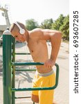 fit man exercising at the park  ... | Shutterstock . vector #693607285