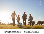 young family running after a... | Shutterstock . vector #693609361