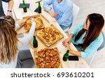 workers eating pizza in the... | Shutterstock . vector #693610201