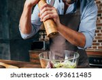 cropped shot of man adding... | Shutterstock . vector #693611485