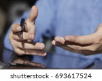 close up of a man holding a... | Shutterstock . vector #693617524