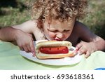 a little boy with curly hair is ...   Shutterstock . vector #693618361