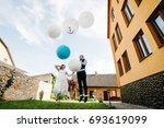 stylish happy bride and groom...   Shutterstock . vector #693619099