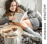 cute girl on a comfortable... | Shutterstock . vector #693637249